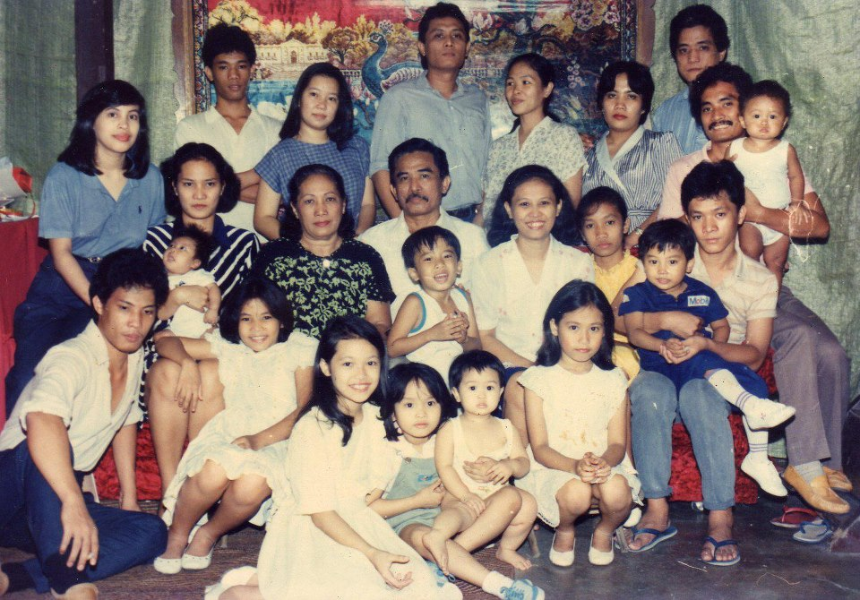 Luz with her mom, dad, and the rest of her family in the Philippines.